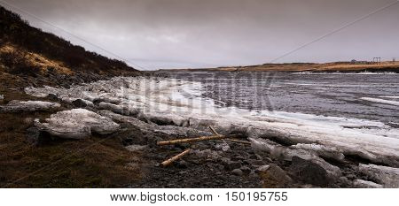 Typical Icelandic Frozen lake with big ice cubes in the island of Iceland early in spring time
