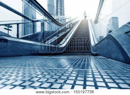 China Shanghai Lujiazui financial district escalators and walking man.
