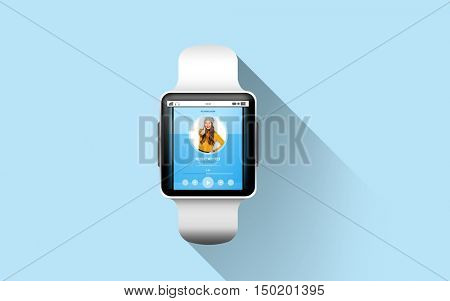 modern technology, object and media concept - close up of black smart watch with music player on screen over blue background