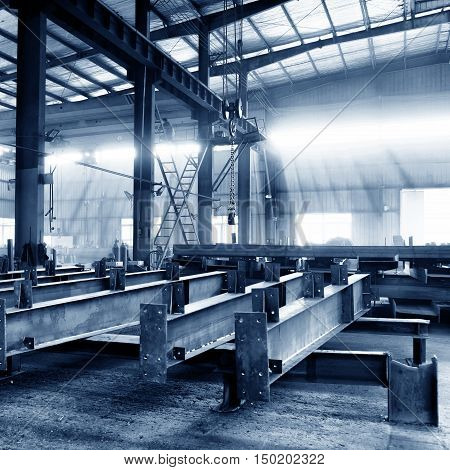 Steel factory floor stacked with a lot of steel