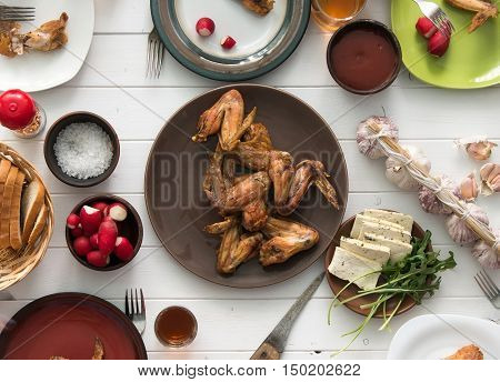 dinner with roasted chicken wings top view
