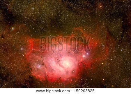 Lagoon Nebula. This giant cloud of gas and dust is creating intensely bright young stars, and is home to young stellar clusters. Retouched colored image. Elements of this image furnished by NASA.