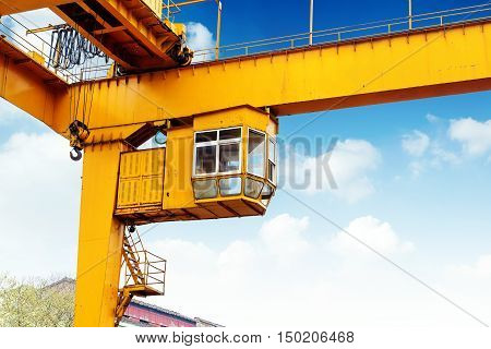 Sky background, orange pier on the bridge crane crane