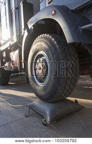 high wheel truck with an air bag for repair