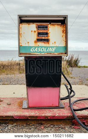 Old dirty gas station, symbolizing the end of fossil energy