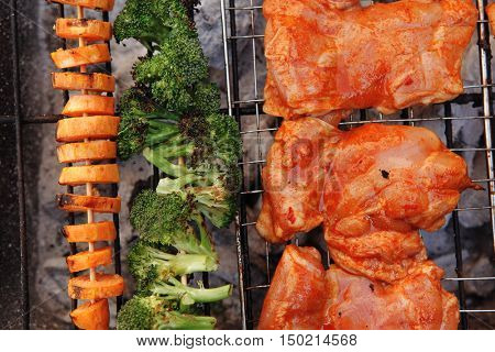 fresh chicken breast meat with vegetable kebab cooked on bbq grid