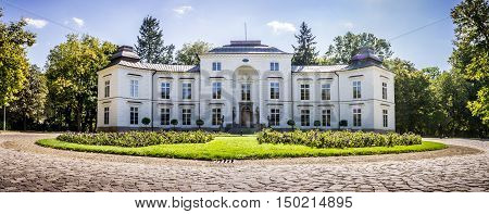 WARSAW POLAND - SEPTEMBER 27: Myslewicki Palace in Royal Baths Park Lazienki Park in Warsaw Poland on September 27 2016