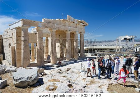 Athens, Greece - April 17th, 2016: People at Parthenon temple entrance on the Acropolis in Athens, Greece
