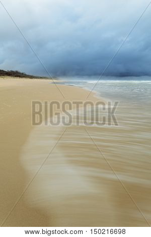 A stormy morning on 75 Mile Beach, Fraser Island, Queensland, Australia