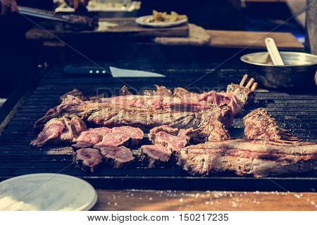 Tasty meat on a barbeque. Street food photography.
