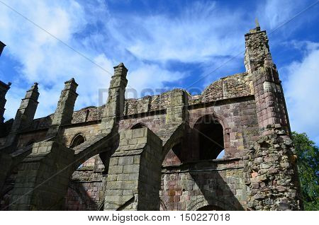 Gorgeous towering ruins of Holyrood Abbey in Edinburgh Scotland.