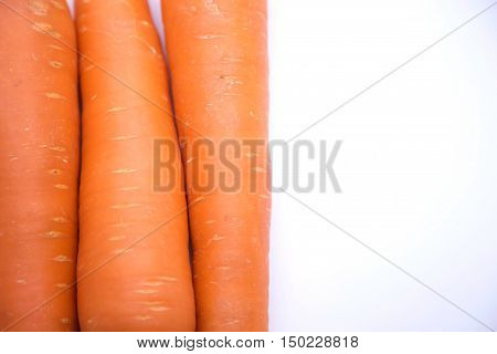 three carrot as a half orange and half white background