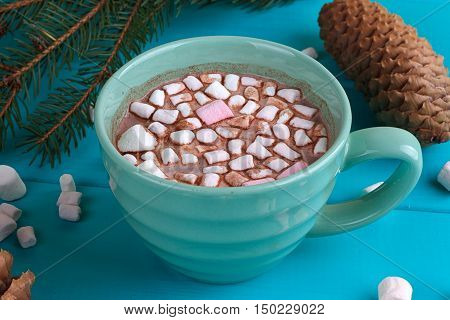 Winter sill life with hot cocoa marshmallows pine and cones top view