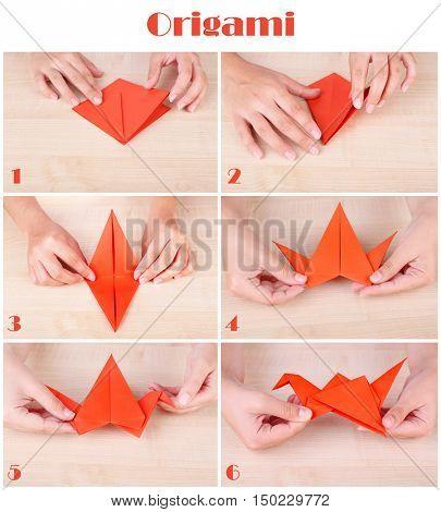 Origami tutorial. Female hands folding paper crane. Hobby and handicraft concept.