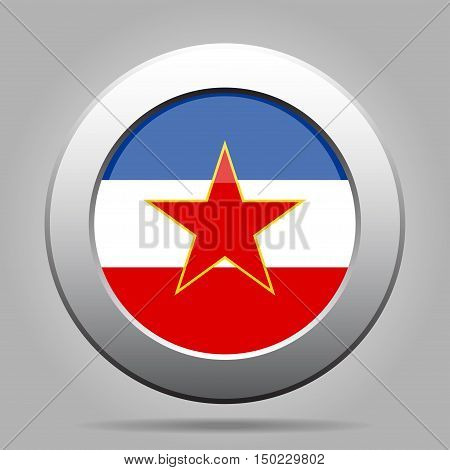 metal button with the national flag of Yugoslavia on a gray background
