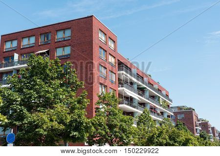 Red modern apartment houses seen in Berlin, Germany