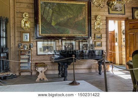 TROLDHAUGEN, NORWAY - JULY 3, 2016: This is living room holiday home of composer Edvard Grieg with his own piano.