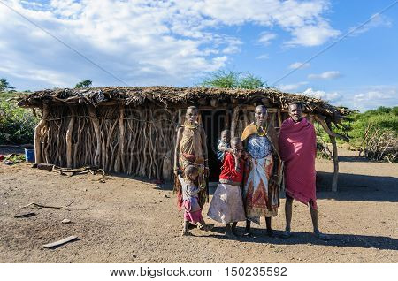 LAKE EYASI, TANZANIA - MAY 29, 2015: A Datoga family in front of their home at Lake Eyasi Tanzania