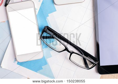 Smartphone And Tablet On Business Report