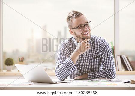 Smiling Man At Workplace