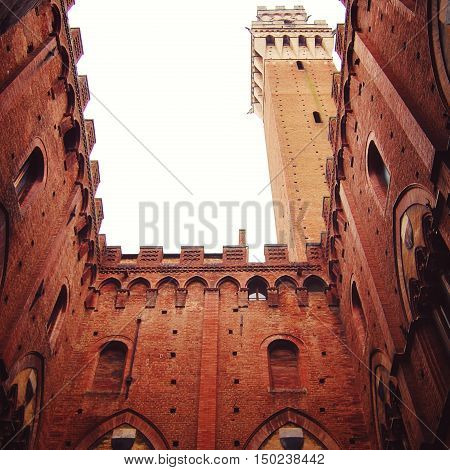 Siena Town Hall And Bell Tower. Inner Yard View.