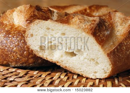 Freshly baked french baguette photographed in warm, afternoon sunlight to emphasize the texture.  Close-up with shallow dof