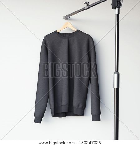 Black Blank Sweatshirt On Modern Hanger. 3D Rendering