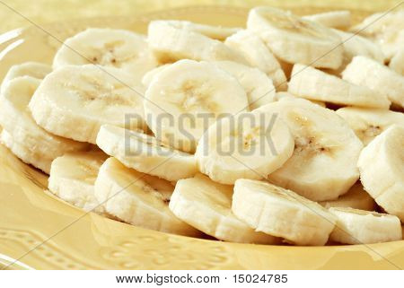 Freshly sliced bananas on a decorative plate.  Macro with shallow dof.
