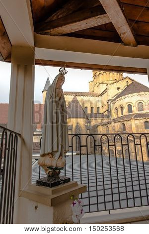 The basilica du Sacre Coeur in Paray-le-Monial France and the statue of Our Lady of Fatima