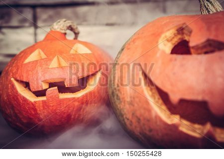 Halloween background with Jack O lanterns in mist