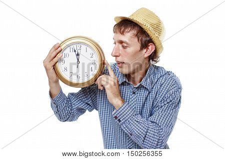joyful guy with a clock. clock point at five minutes to midnight. the concept of New Year holiday. isolated on white background