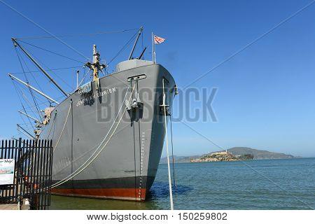 World War II Liberty ship SS Jeremiah O'Brien and Alcatraz Island, in Fisherman's Wharf, San Francisco, California, USA