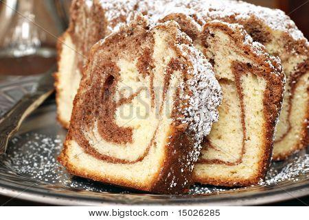 Freshly baked cinnamon swirl coffee cake.  Macro with shallow dof.