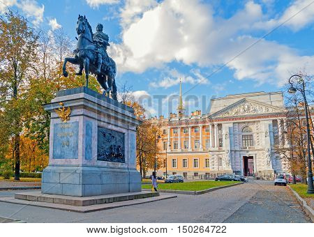 ST PETERSBURG RUSSIA-OCTOBER 3 2016. Monument to emperor Peter the Great on the background of Mikhailovsky or Engineer Castle in St Petersburg Russia. Autumn view of St Petersburg landmarks