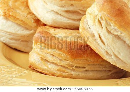 Freshly baked homemade biscuits on decorative plate.  Macro with shallow dof.