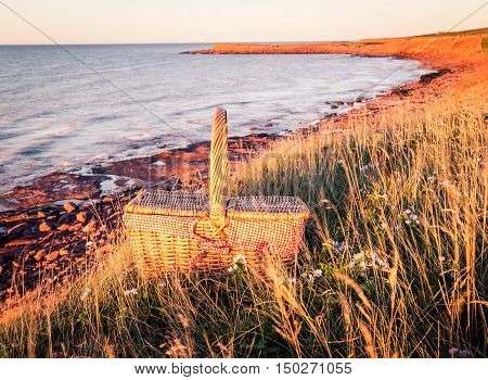 Picnic basket in prince edward island with atlantic ocean