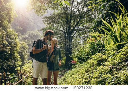 Couple In Love Kissing While Hiking