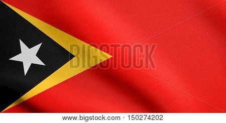 East Timorese national official flag. Patriotic symbol banner element background. Accurate dimensions. Correct size colors. Flag of East Timor waving in the wind with detailed fabric texture, 3d illustration