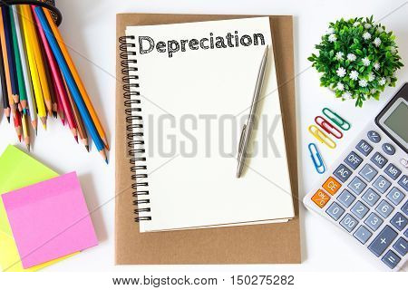 depreciation text message on white paper and office supplies, pen, paper note, on white desk , copy space / business concept / view from above, top view