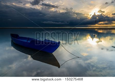 The Fisherman Boat with beautiful sunrise at Nagalang beach, Labuan, Malaysia.