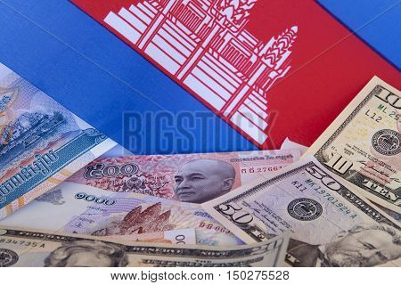 Cambodian currency: Cambodian riel, American dollars and flag.