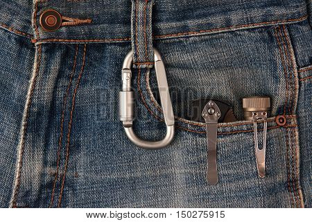 metal carabiner and tools on the jeans