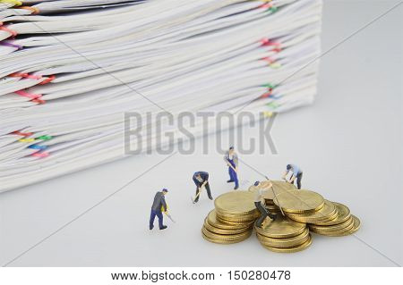 Miniature People And Pile Overload Document With Gold Coins