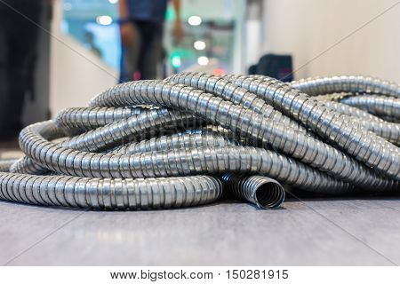 Flexible metal pipe on construction site .
