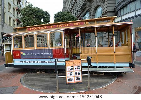 SAN FRANCISCO - MARCH 14: Antique Cable Car on Powell Street Turntable on March 14th, 2014 in San Francisco, California, USA.