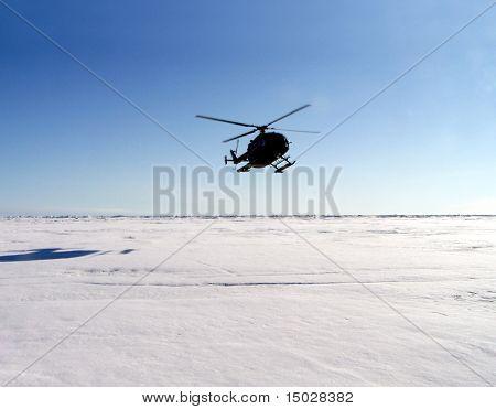 Helicopter landing in Antarctica