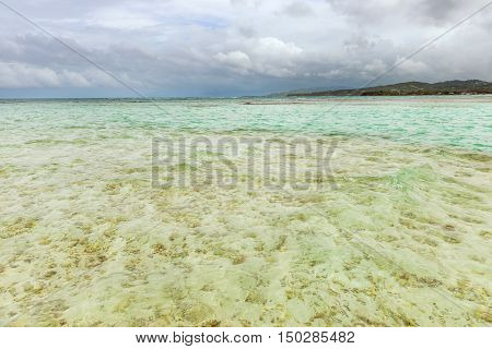 Nylon Pool in Tobago tourist attraction shallow depth of clear sea water covering coral and white sand panoramic view