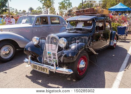 Laguna Beach, CA, USA - October 2, 2016: This black 1954 Citroen Traction Avant was driven in South Africa and Botswana for 20 years before ending up in a barn in Quebec, Canada for 30 years. It was restored and is now owned by Rodney Pick and was display