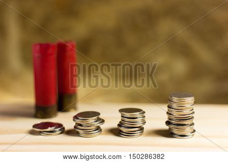Staircase Of Money, Thai Coins Of One Bath On Wood And Shotgun Shell Background.concept Of Financial