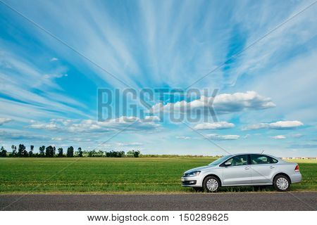 Gomel Belarus - June 13 2016: View from the Volkswagen Polo on the background of a beautiful sky with clouds and green field